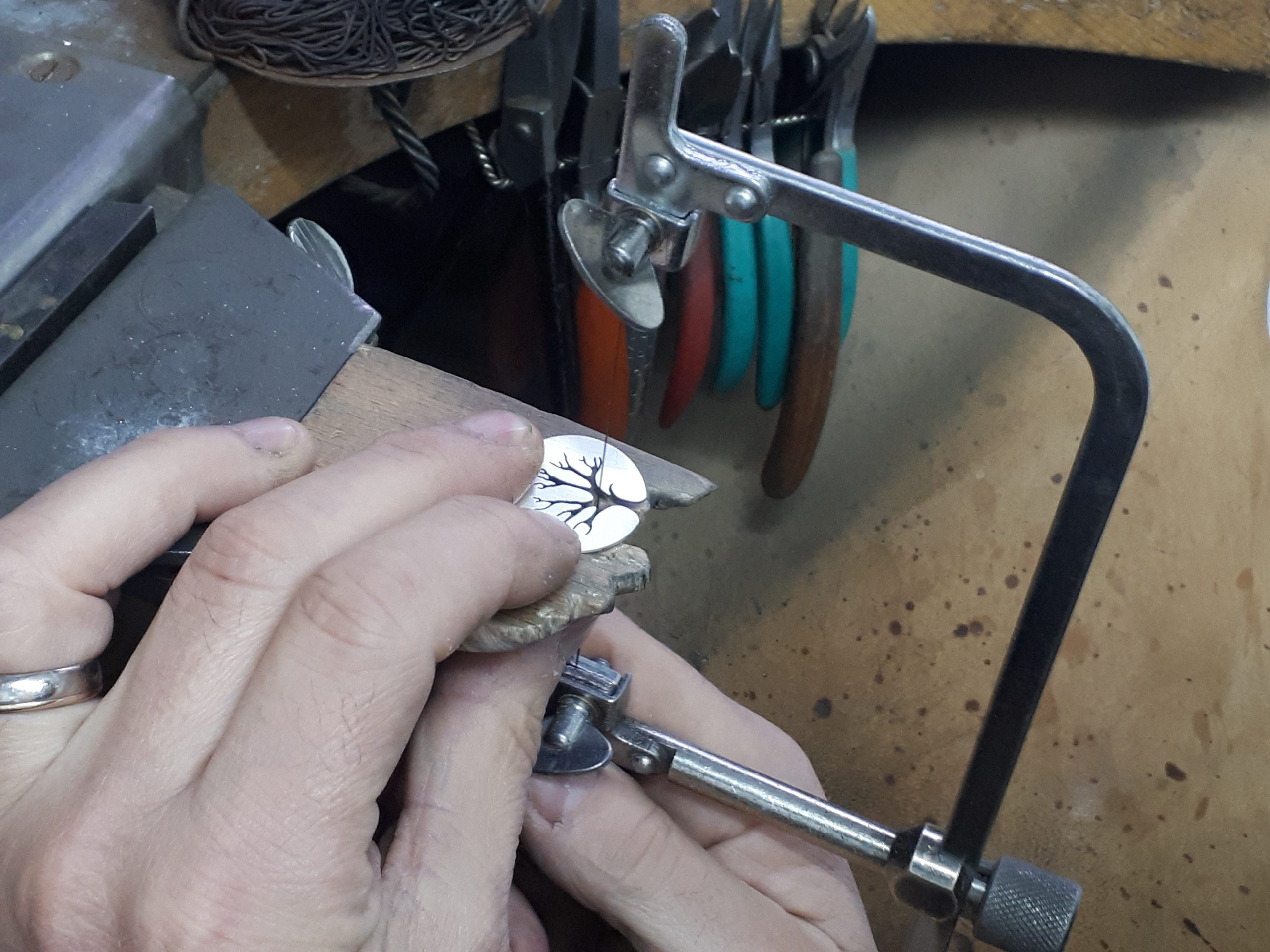Hand cutting a pendant
