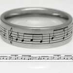 Platinum wedding ring. Laser engraved with the couples first dance