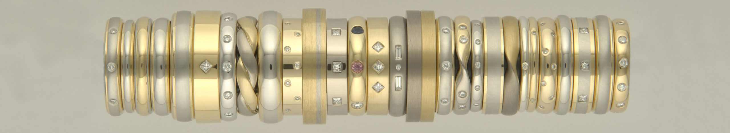 Tower of two coloured wedding rings